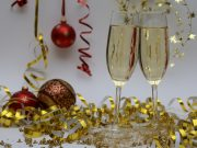 New Year's Eve celebrate: two champagne glasses with confetti surrounding it