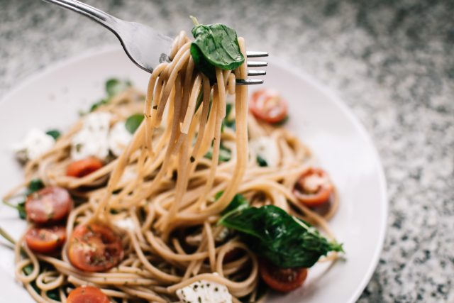 New Year's Eve: bowl of wheat noodles with tomato, basil, and chungs of cheese
