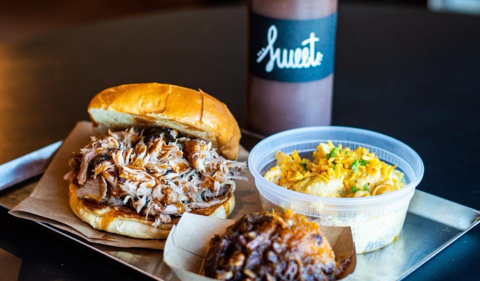lexington restaurant: bbq sandwich with two sides and sweet bbq sauce bottle
