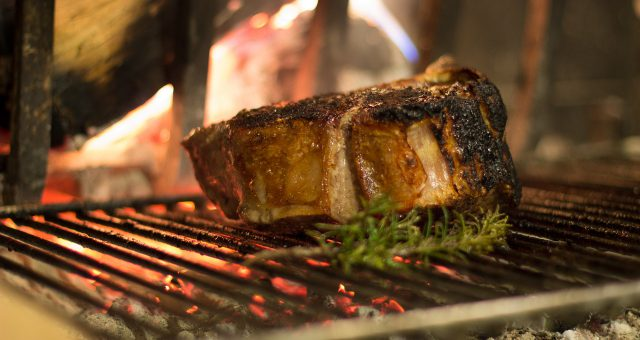 charity: steak on a grill with rosemary