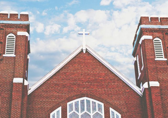 Easter Service: brick church with white trim