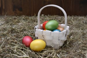 Easter Egg Hunts: colored eggs in a white basket