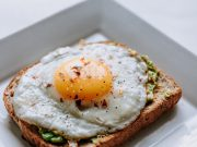 Brunch: fried egg with an avocado spread on toast