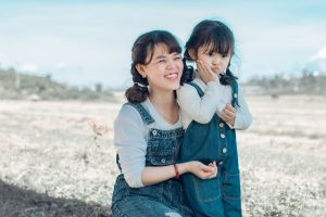 Mother's Day: mom and daughter in matching overalls