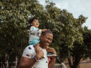 Father's Day: a young boy on his father's shoulders