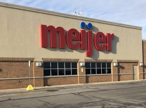 Thanksgiving: beige building with meijer in red