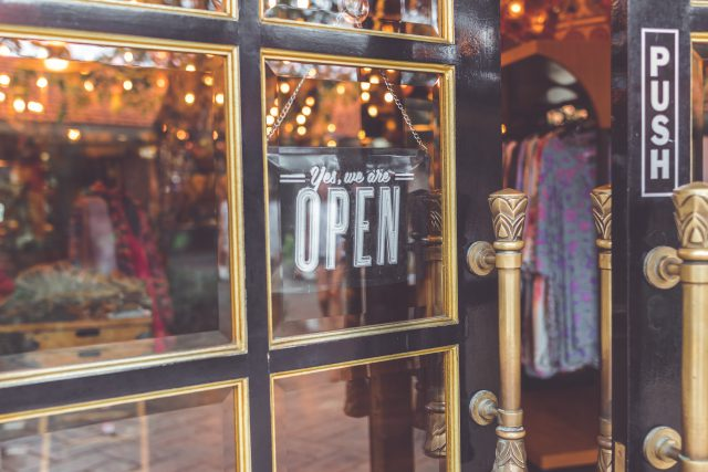 Christmas: a door that has a yes we're open sign