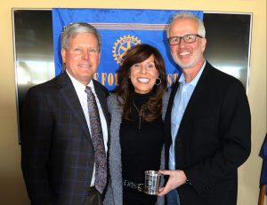 humanitatiran: two men and a woman holding an award and smiling at the camera